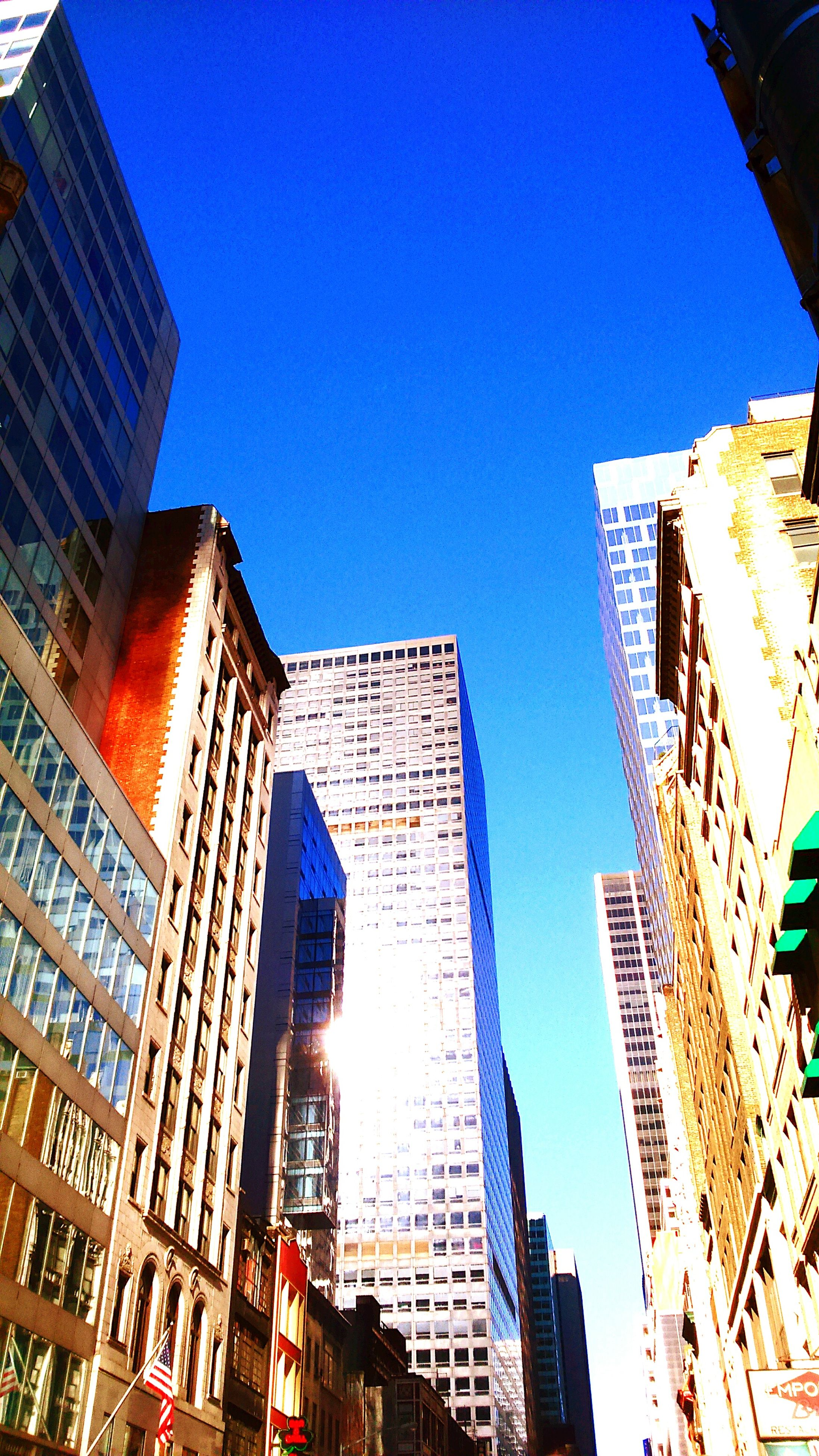 building exterior, architecture, built structure, low angle view, clear sky, city, blue, skyscraper, modern, office building, building, tall - high, tower, residential building, city life, day, outdoors, residential structure, no people, tall
