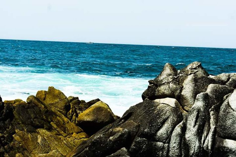 Beauty In Nature Sea Horizon Over Water Beach Rock - Object Water Nature Rock Formation Scenics Outdoors Beauty In Nature Cliff Travel Destinations Tranquility No People Sky Day Tranquil Scene Wave Sunlight Vacations