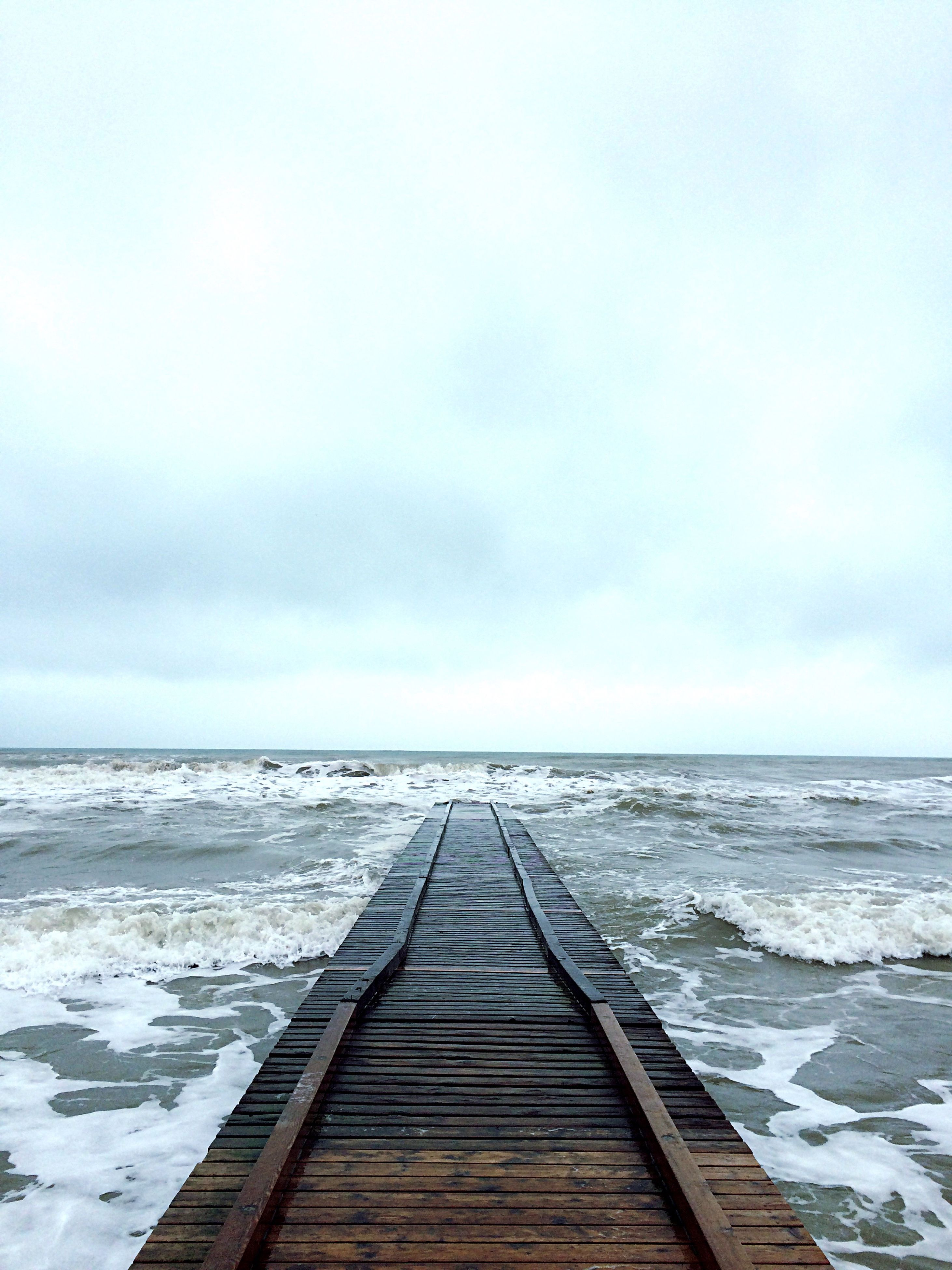 sea, horizon over water, water, pier, sky, the way forward, tranquil scene, tranquility, scenics, wood - material, jetty, beach, beauty in nature, nature, boardwalk, idyllic, diminishing perspective, shore, long, wood