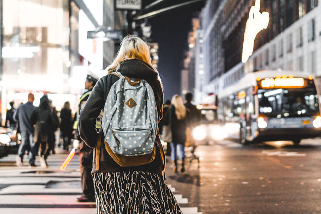 Backpack Blurred Motion Car City Life Depth Of Field Fashion Girl Lifestyles New York Night NYC NYC Photography Real People Rear View Street Style Three Quarter Length Urban Women Market Bestsellers May 2016 Market Bestsellers July 2016 Bestsellers