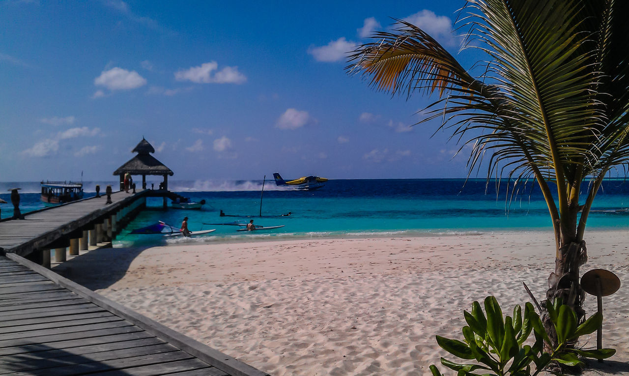 Beach Maledives Palm Pier Sand Sea Sky And Clouds Starting A Trip Water Waterplane