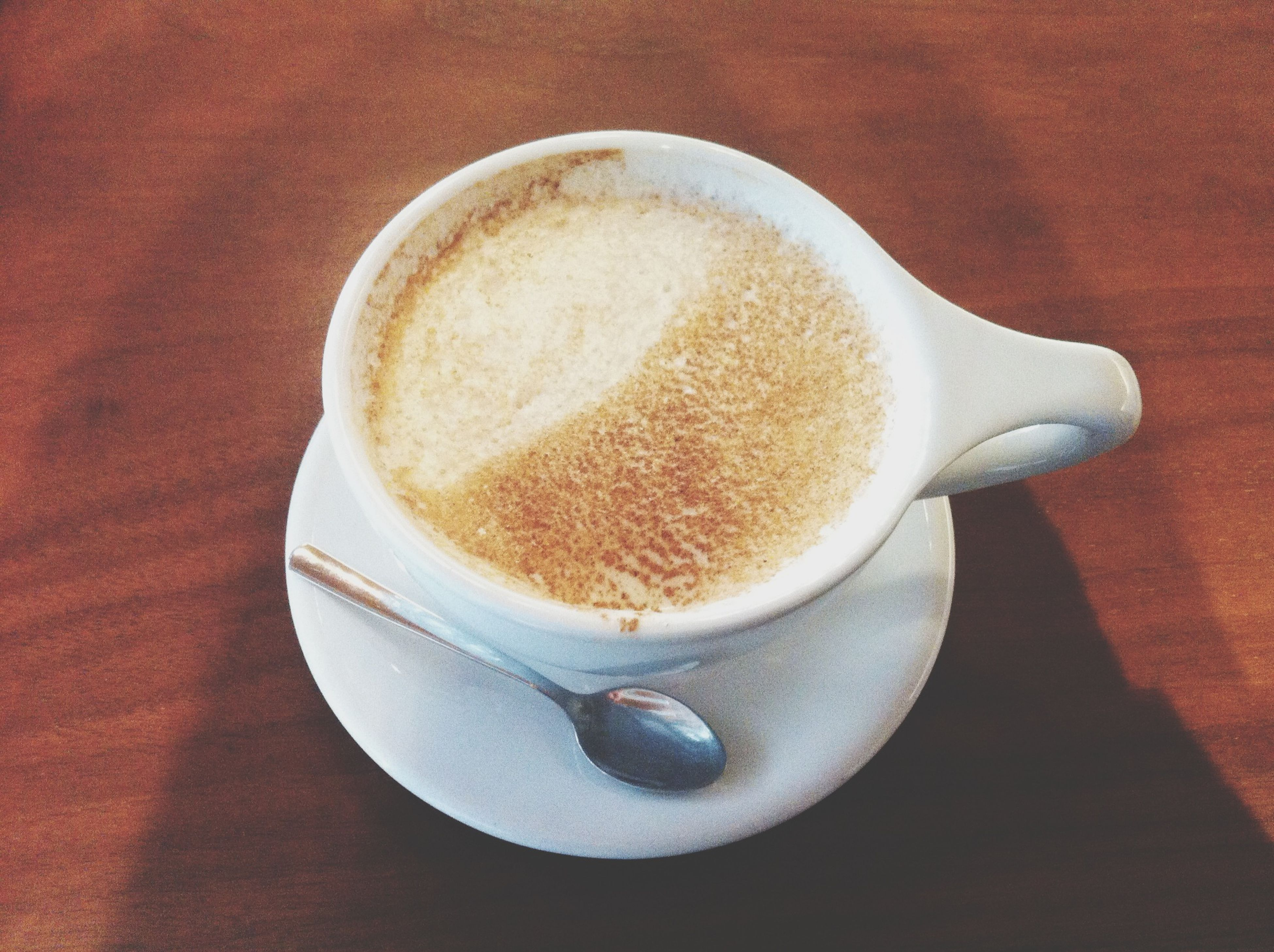 food and drink, drink, refreshment, coffee cup, indoors, coffee - drink, table, saucer, still life, freshness, frothy drink, coffee, close-up, high angle view, cappuccino, spoon, cup, froth art, beverage, no people