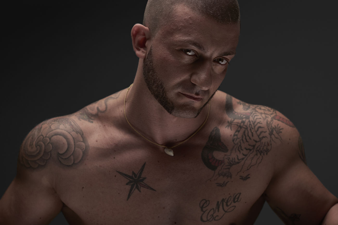 Simone, colored version Black Background BodyBuilder BodybuilderLifeStyle Close-up Eyes Front View Muscular Build One Person Portrait Real People Shirtless Strength Studio Shot Tattoo The Portraitist - 2017 EyeEm Awards Trainer Young Adult