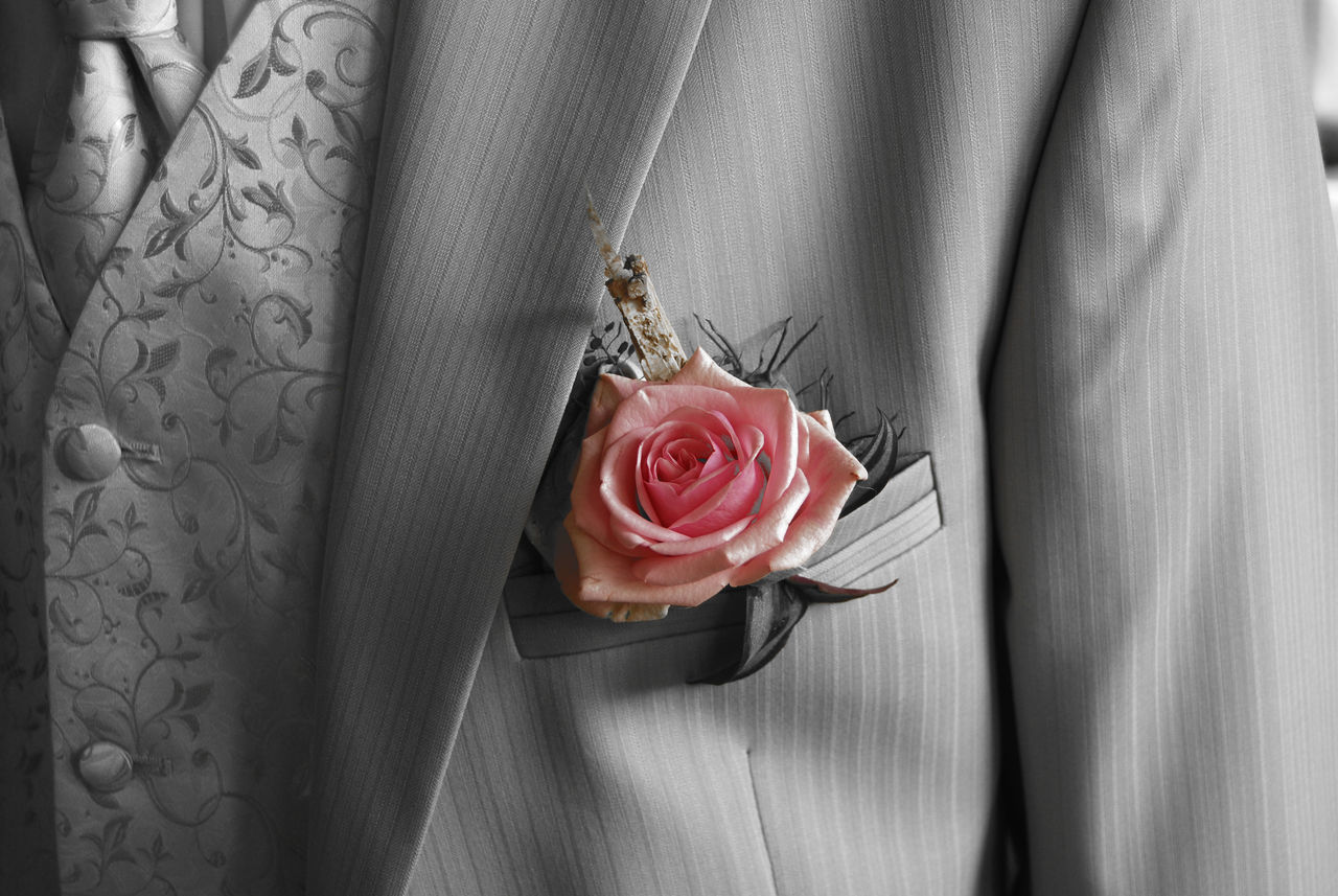 Close-Up Of Rose On Pocket Of Suit