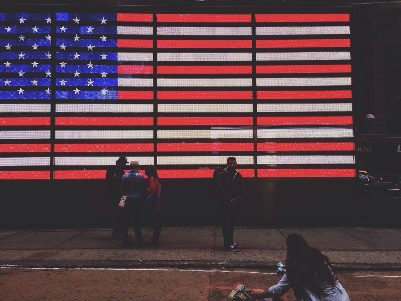 flag, patriotism, striped, real people, men, outdoors, stars and stripes, transportation, women, standing, day, lifestyles, built structure, travel destinations, architecture, people