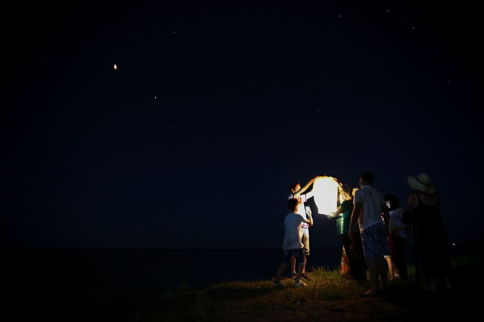 Adult Astronomy Field Friendship Full Length Men Moon Nature Night Outdoors People Sea Sky Small Lamp Star - Space Young Adult