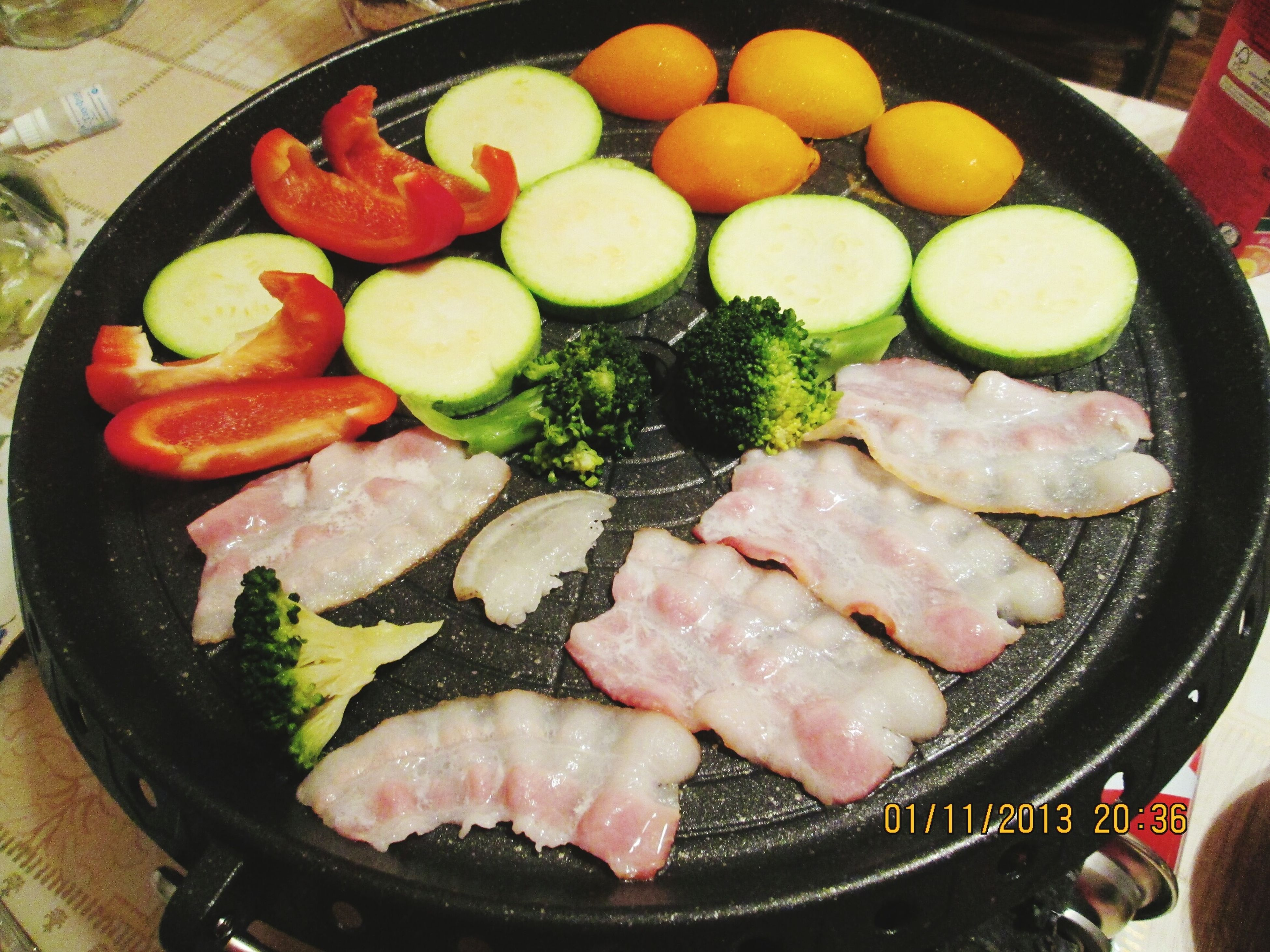 food and drink, food, freshness, healthy eating, indoors, meat, cooking, vegetable, preparation, seafood, high angle view, still life, meal, preparing food, ready-to-eat, close-up, frying pan, cooking pan, healthy lifestyle, fish