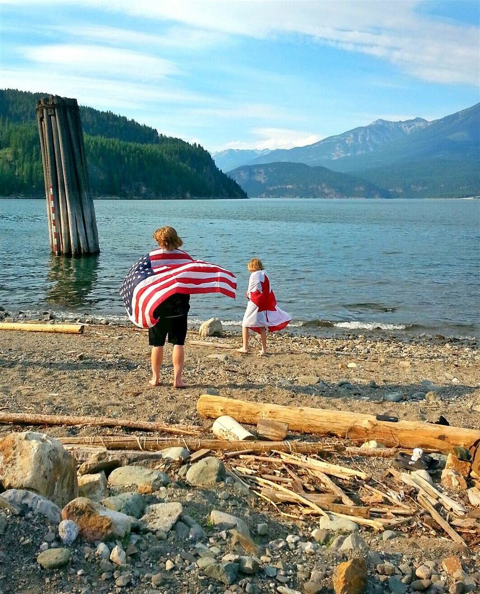 Brotherly love. Childhood Outdoors Mountain Nature Children Children Only Canada Photos Canadian Flag American Flag Candian And American Canadian And American Flag Natural Beauty Summer Day Waterfront Mountains Nature Canada Sunny British Columbia British Columbia, Canada Canada Flag Flags Patriotic Patriotism Patriotism In Nature