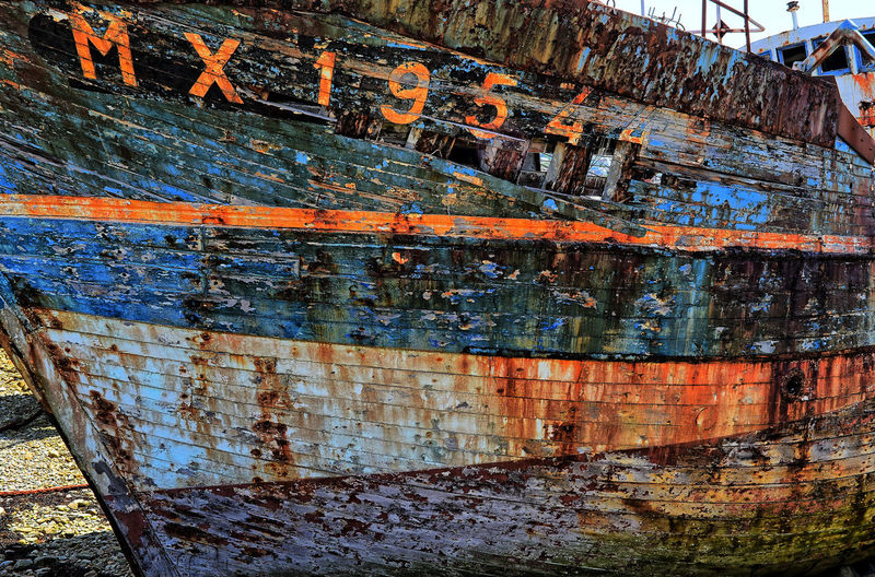 Ship recycling at Camaret-Sur-Mer Blue Orange Wrecked Ship Ship Run Aground Ship Breakers Recycling Camaret-sur-Mer Brittany Wrecked Ship Cloud - Sky Nautical Vessel Ship Salvage Water Wrecked Boat. Wrecked Ship Wood - Material Weathered Day No People Textured  Bad Condition Outdoors Close-up