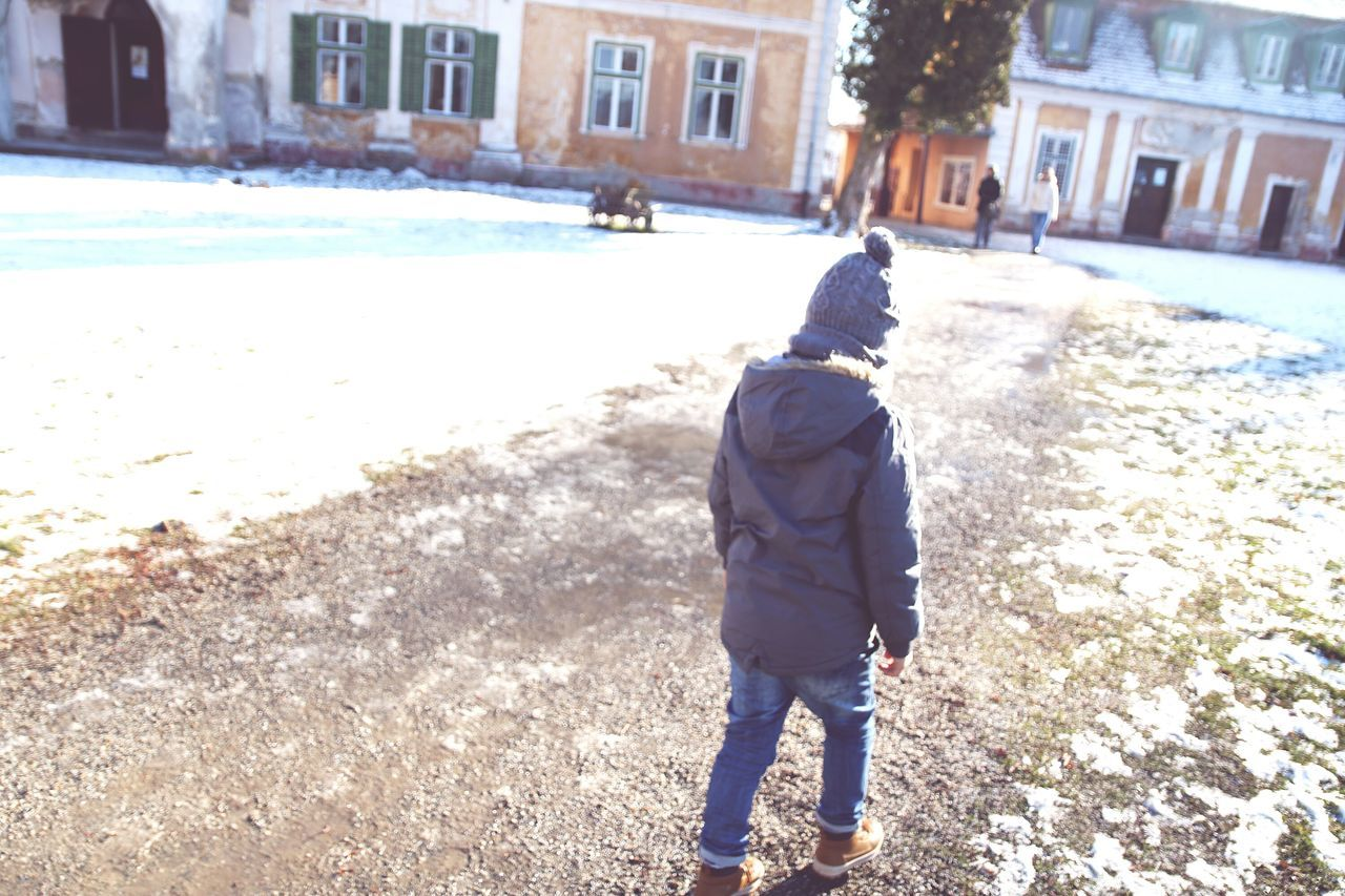 Winter Cold Temperature One Person Warm Clothing Rear View Snow Outdoors Day People Adult Childhood Loop Boy