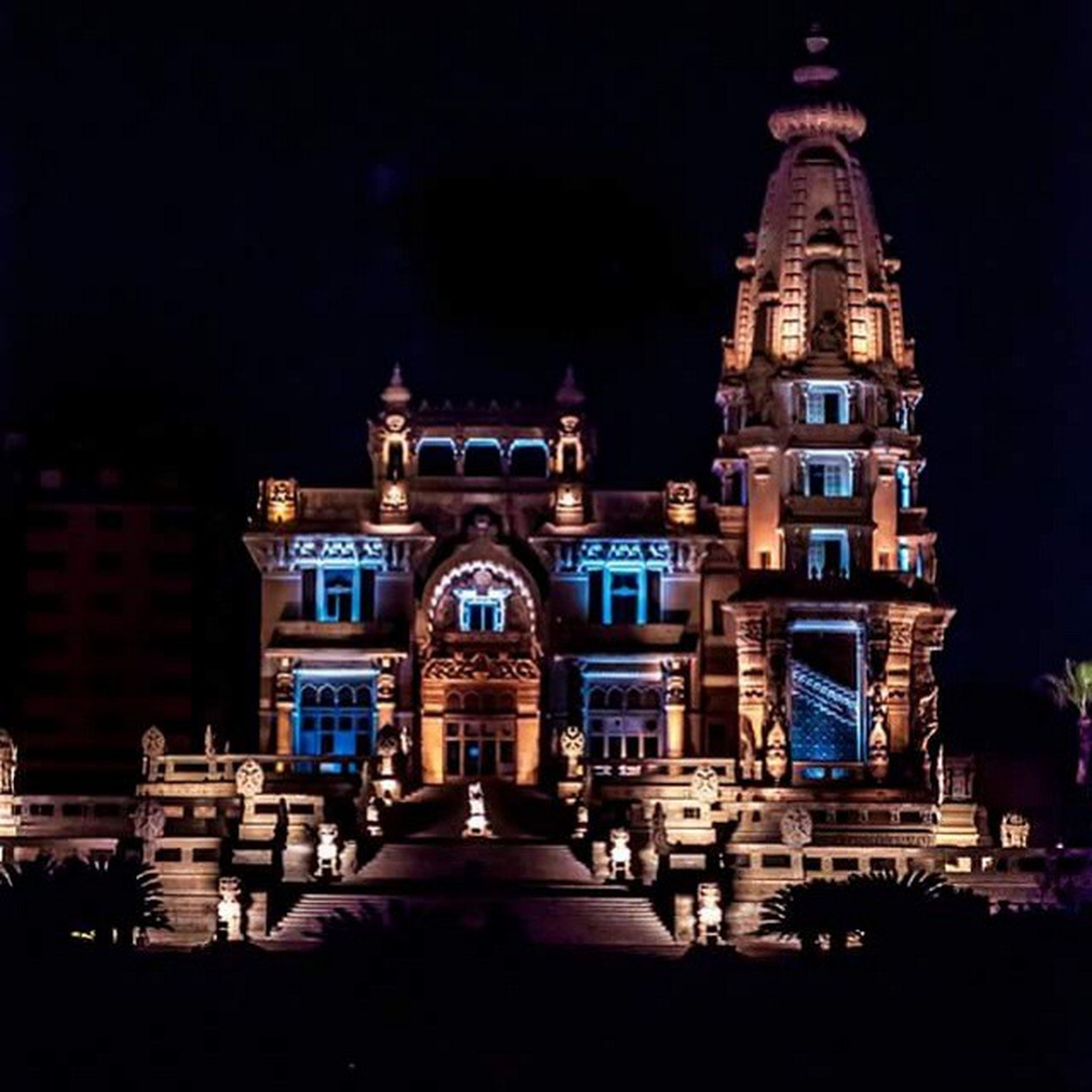 building exterior, architecture, religion, place of worship, built structure, spirituality, church, night, cathedral, dome, illuminated, facade, travel destinations, famous place, city, sky, history, low angle view
