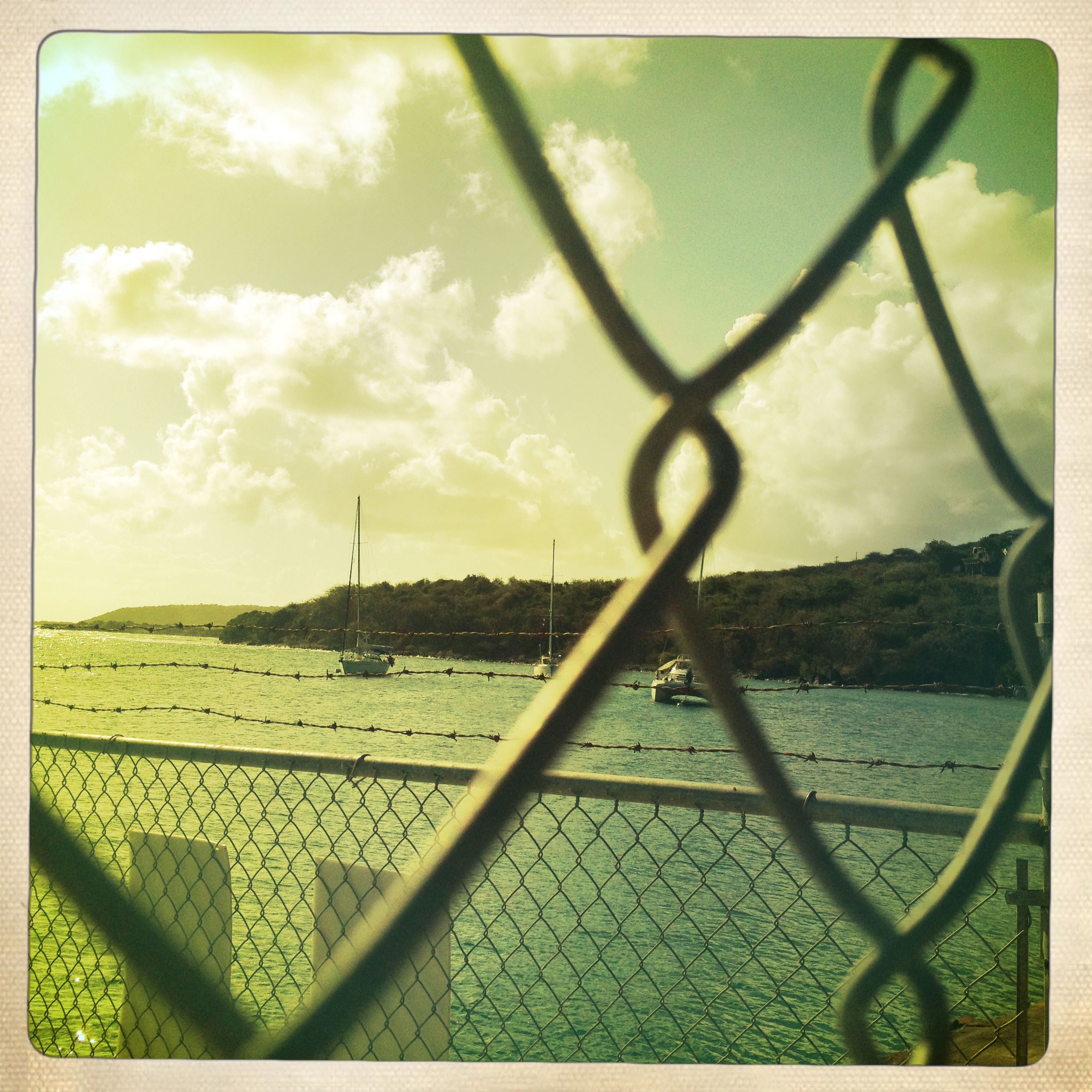 transfer print, auto post production filter, sky, water, cloud - sky, railing, metal, fence, nature, tranquility, river, sea, cloud, cloudy, outdoors, tranquil scene, scenics, chainlink fence, day, no people