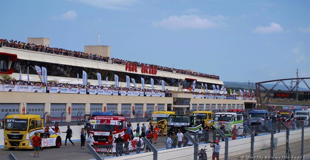 Architecture Building Exterior Built Structure Circuitpaulricard City Crowd Day Land Vehicle Large Group Of People Men Outdoors People Real People Road Sky Transportation Truck Trucks Unclicheunclindoeil Women