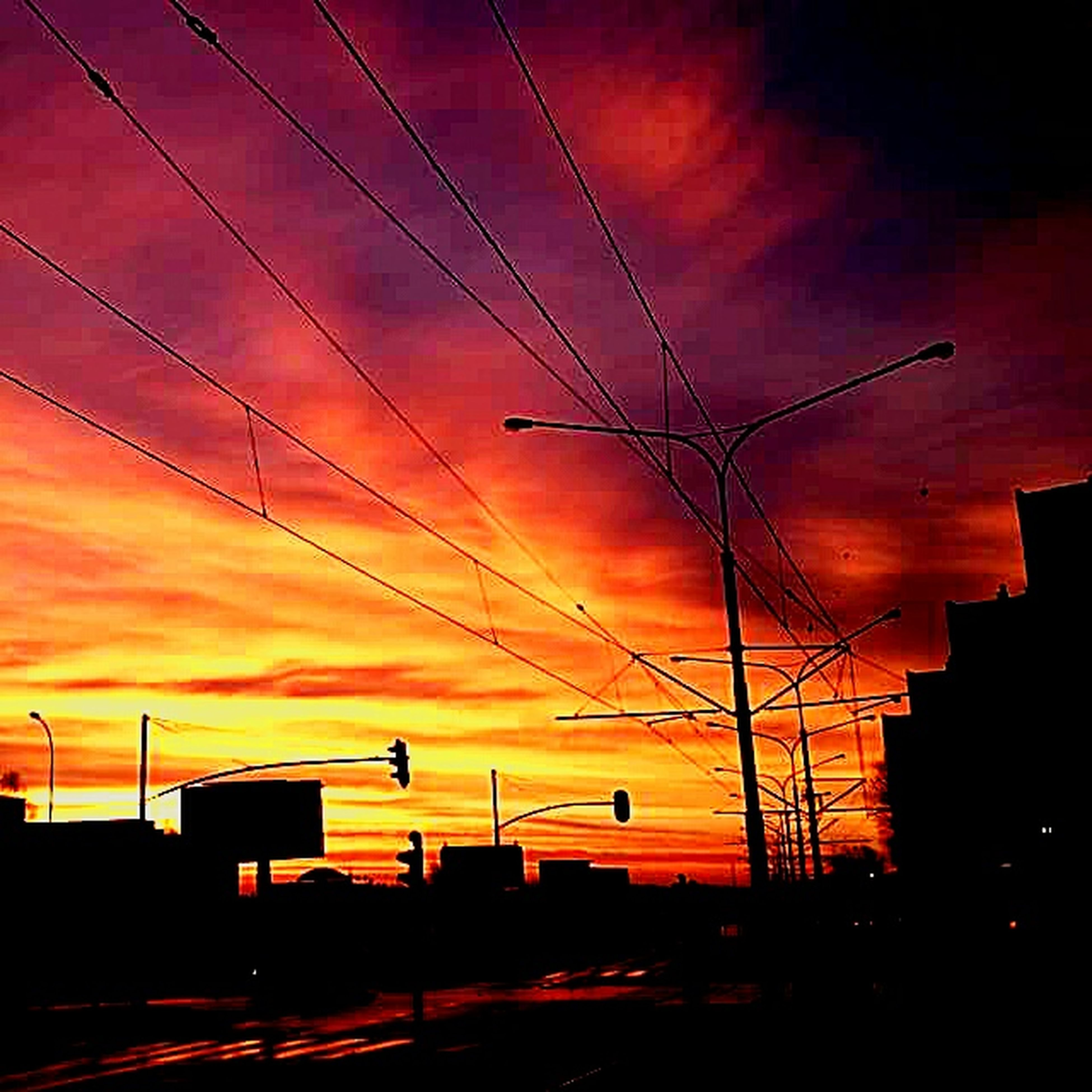 sunset, orange color, sky, silhouette, power line, low angle view, cloud - sky, built structure, cable, architecture, connection, building exterior, electricity pylon, electricity, power supply, street light, dramatic sky, lighting equipment, cloud, cloudy
