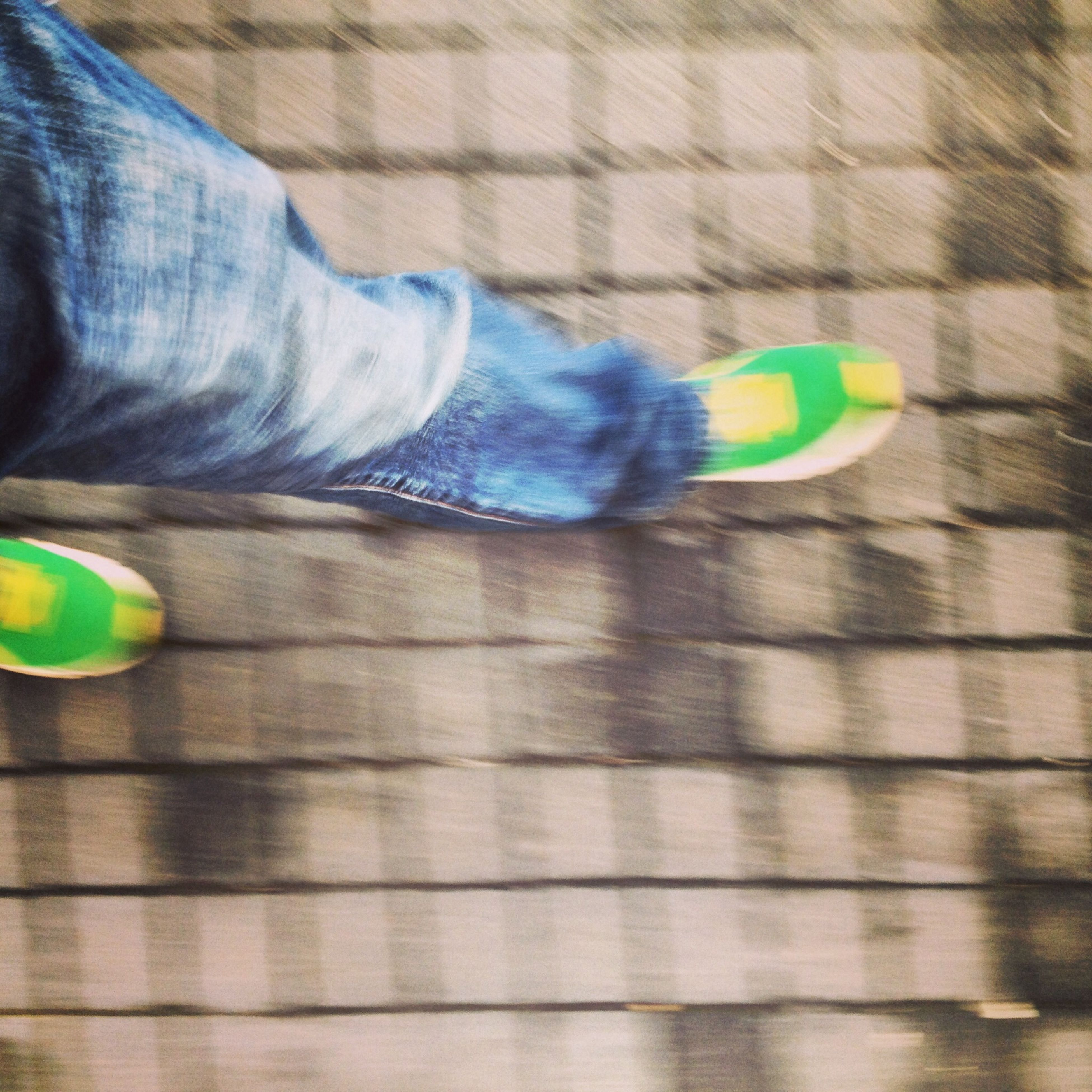 indoors, low section, multi colored, lifestyles, close-up, person, pattern, green color, leisure activity, blue, unrecognizable person, part of, shoe, standing, men, wall - building feature, sport