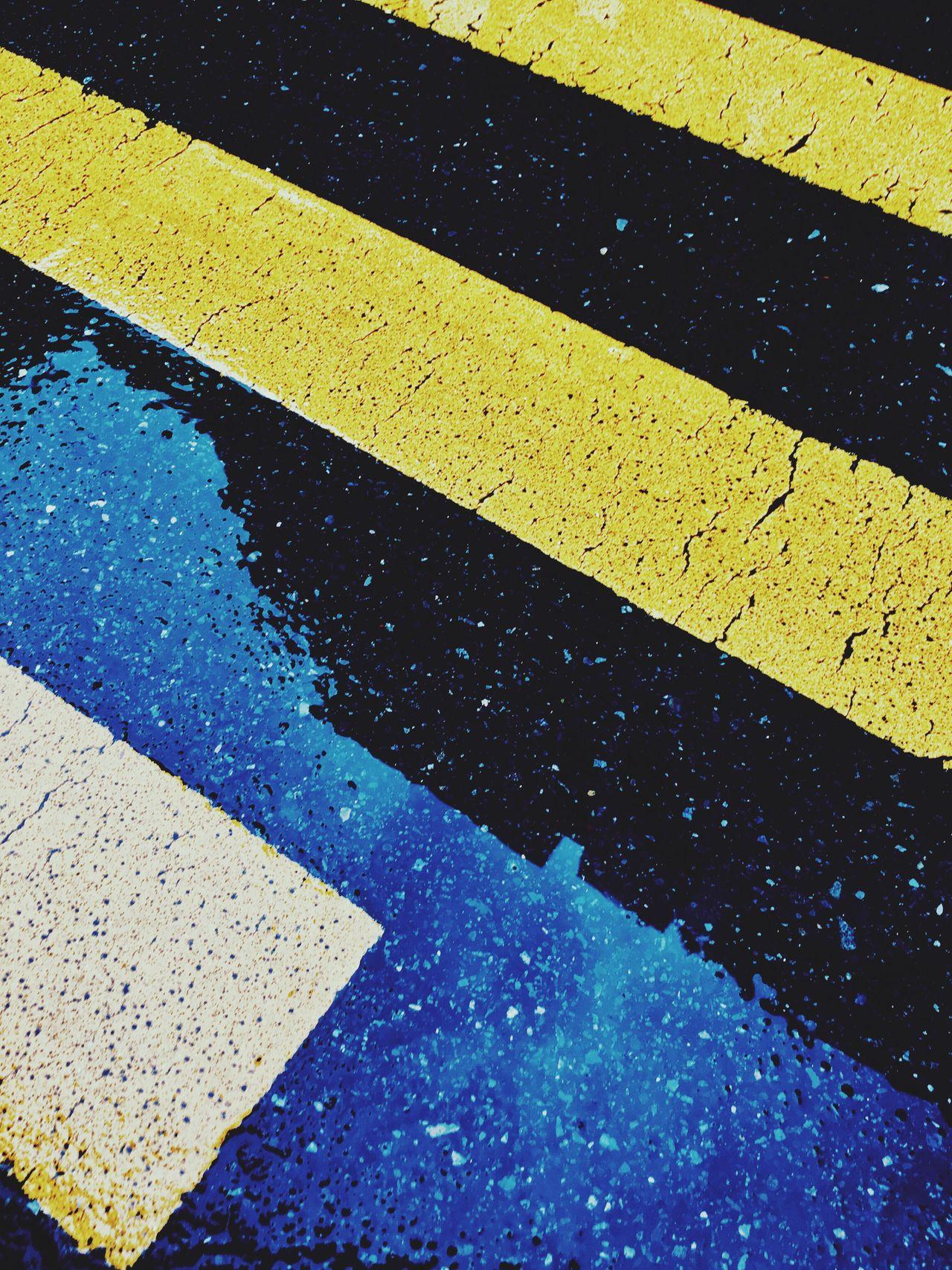 Yellow Road Drops Rain Reflection