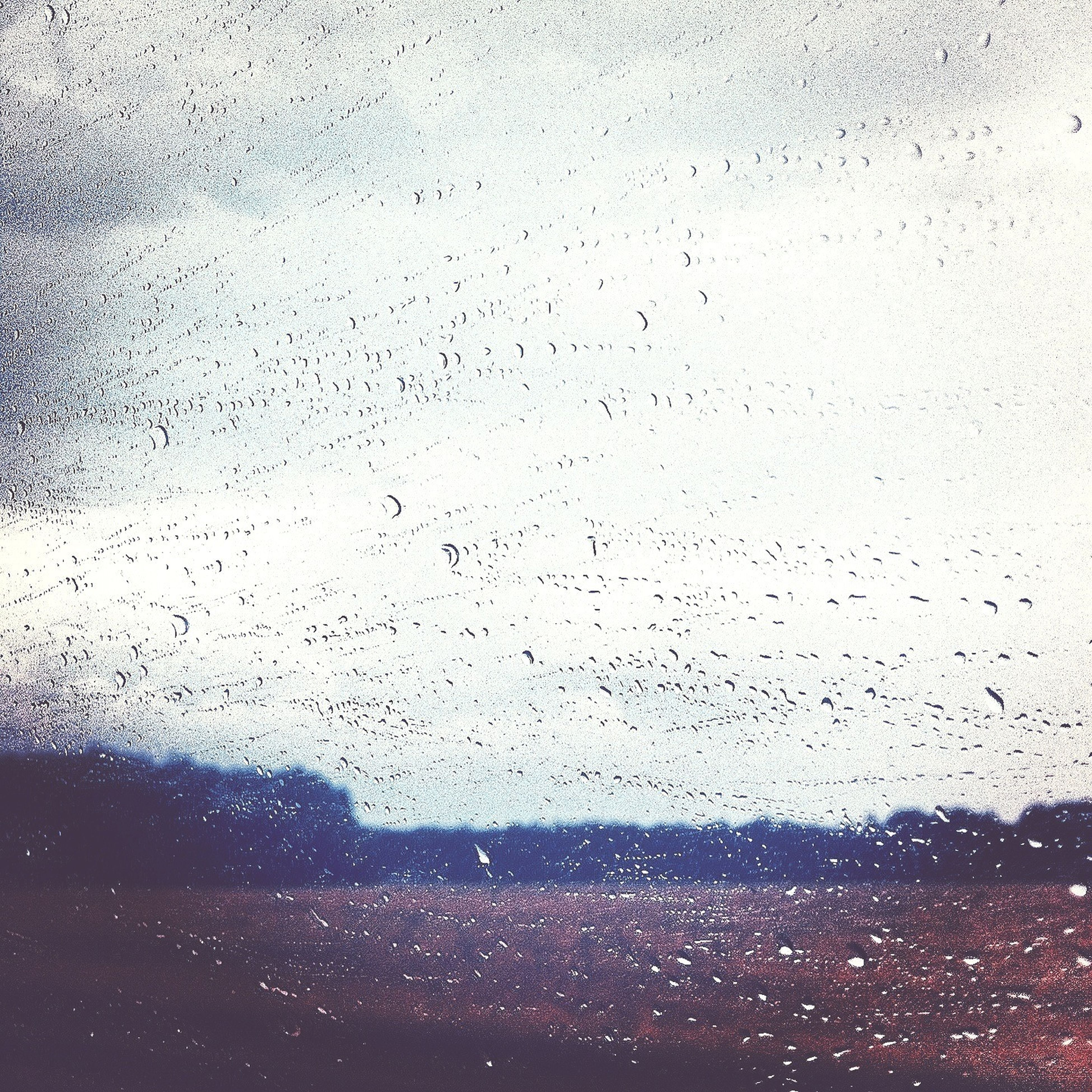 drop, window, wet, transparent, rain, water, glass - material, sky, weather, raindrop, indoors, season, glass, dusk, silhouette, transportation, nature, cloud - sky, looking through window, car