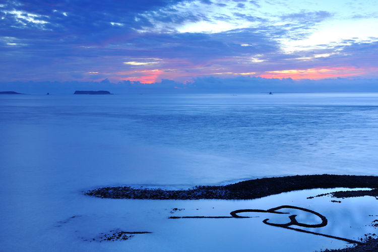 Scenic Penghu Taiwan coast, broad and grand, the four seasons have different feelings. Double Heart Stone Pool Natural Taiwan Beauty In Nature Cloud - Sky Coastal Cold Temperature Day Double Heart Fresh Horizon Over Water Landscape Nature No People Outdoors Peaceful Penghu Scenics Sea Seaside Sky Sunset Tranquil Scene Tranquility Water