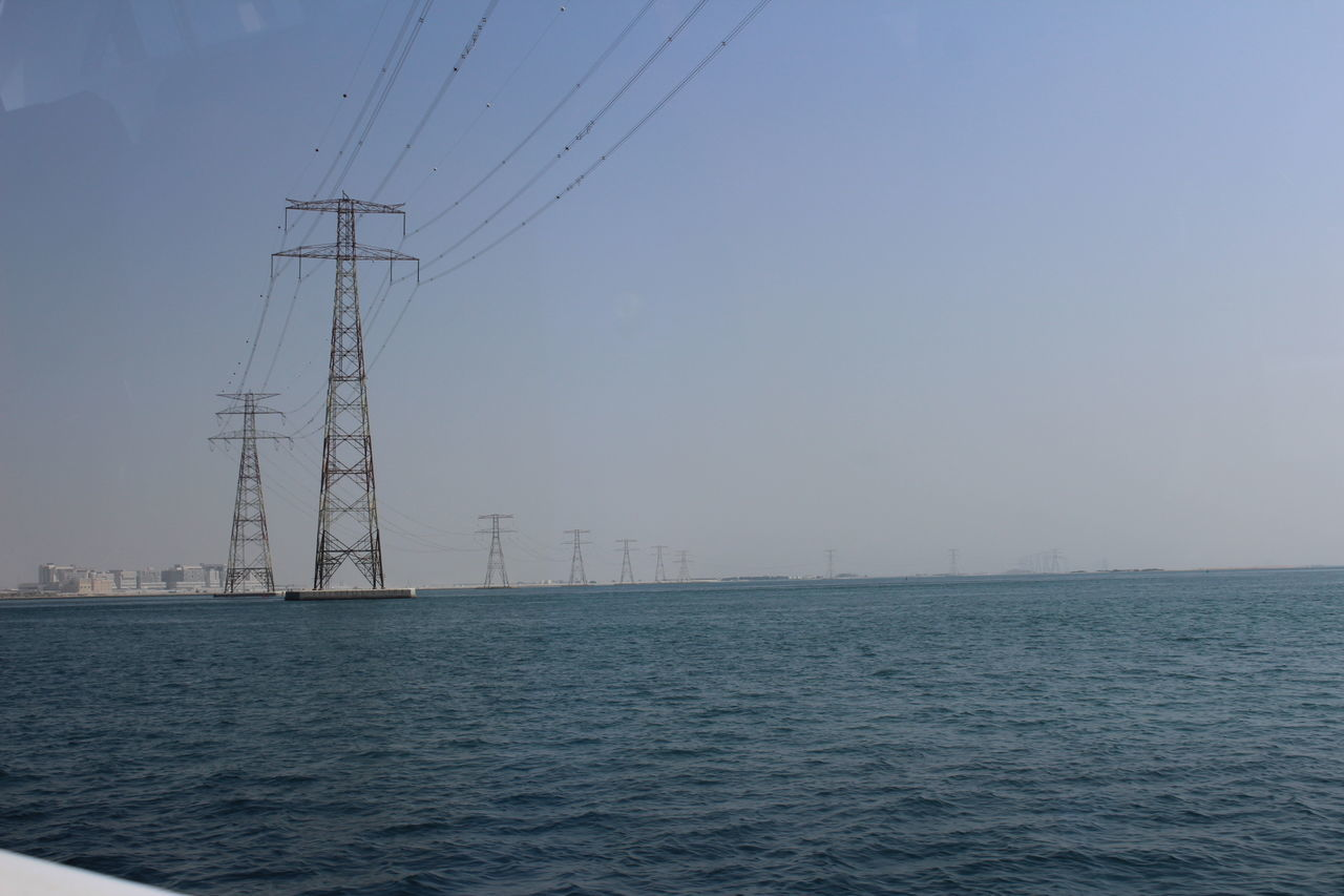 cable, connection, electricity, electricity pylon, fuel and power generation, day, clear sky, outdoors, no people, waterfront, water, sea, sky, tranquility, technology, nature, scenics, beauty in nature