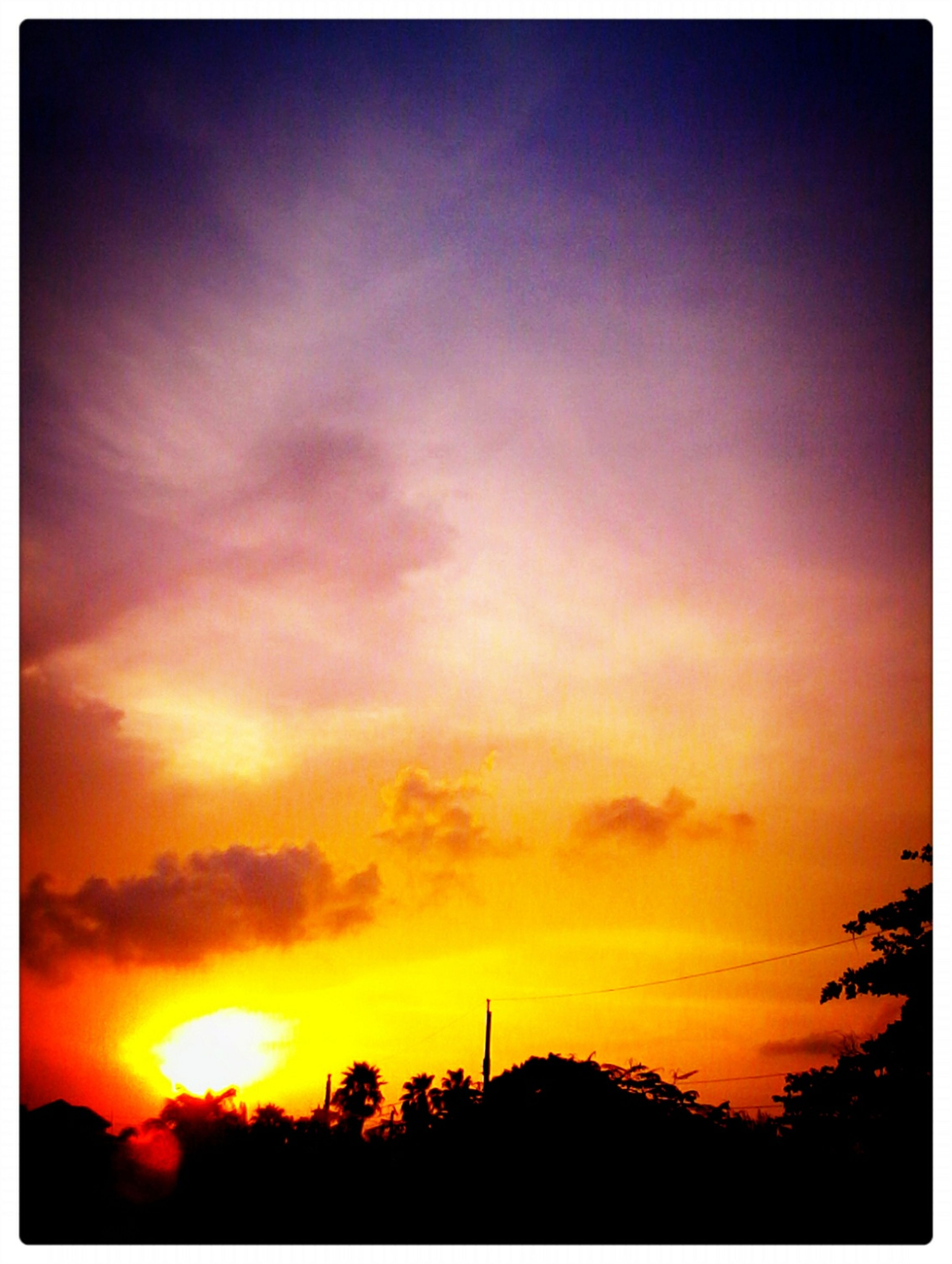 sunset, silhouette, transfer print, orange color, sky, auto post production filter, low angle view, beauty in nature, built structure, cloud - sky, building exterior, scenics, nature, architecture, tree, tranquility, sun, dramatic sky, outdoors, cloud