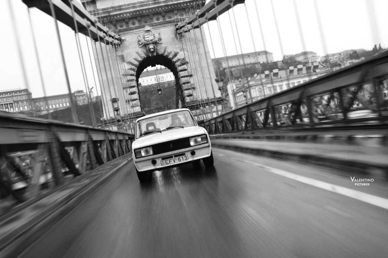 #blackandwhite #budapest #bw #car #ChainBridge #lada #lada1500 #longexposure #motion #retrocar #russian Architecture Bridge - Man Made Structure City Day No People Outdoors Suspension Bridge Traffic Transportation