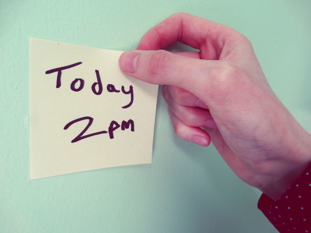 Hand sticking sticky note on wall. Text Human Hand Western Script One Person Human Body Part Indoors  Communication Human Finger Holding Message Real People Close-up Day People Sticky Note Sticky Notes Note Notes Paper Words Office Home