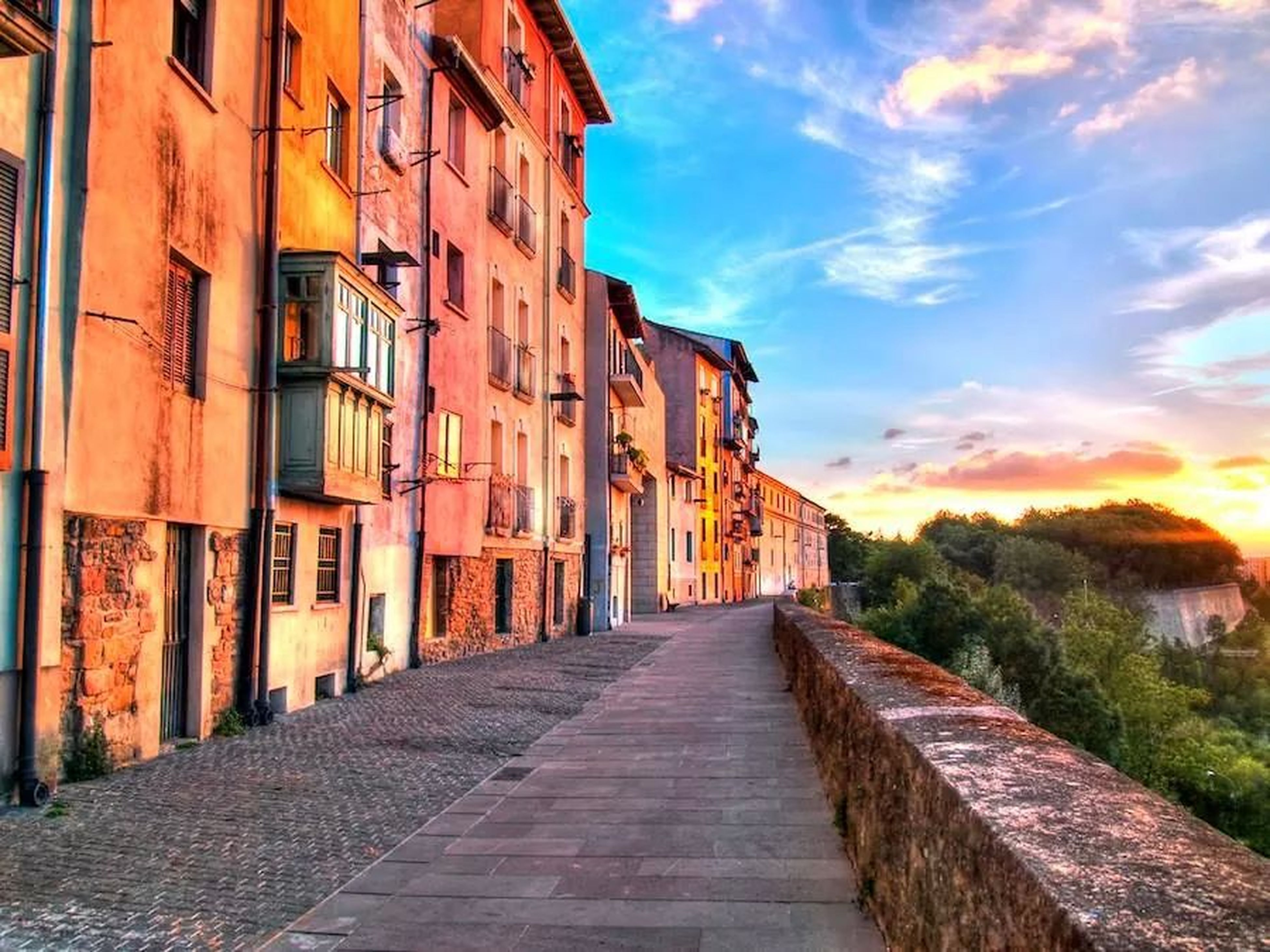 building exterior, architecture, built structure, the way forward, sky, residential structure, residential building, diminishing perspective, house, street, narrow, vanishing point, town, city, cobblestone, building, residential district, cloud - sky, alley, outdoors
