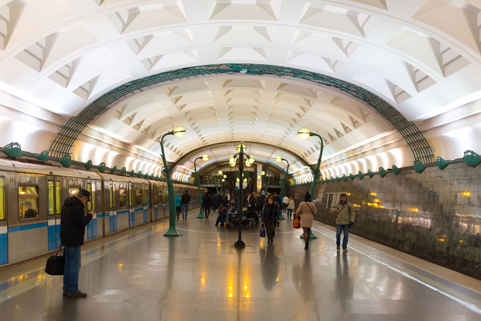 Arch Architecture Built Structure Clock Commuter Group Of People Illuminated Indoors  Large Group Of People Lifestyles Luggage Men Passenger Public Transportation Rail Transportation Railroad Station Real People Train - Vehicle Transportation Transportation Building - Type Of Building Travel Travel Destinations Vacations Walking Women