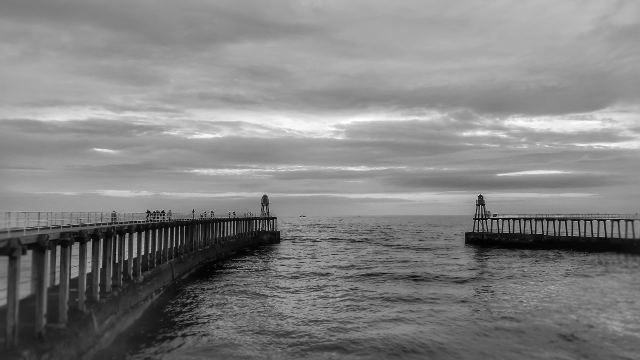 Whitby pier on a cold day Sea Landscape Pier Coastline Beauty In Nature Outdoor Photography Creative Light And Shadow Malephotographerofthemonth Bnw_captures Monochrome Photography Black And White Portrait Black And White Photography Outdoor Beauty Landscape Photography Focus On Foreground Whitby Pier Whitby View Yorkshire Coast