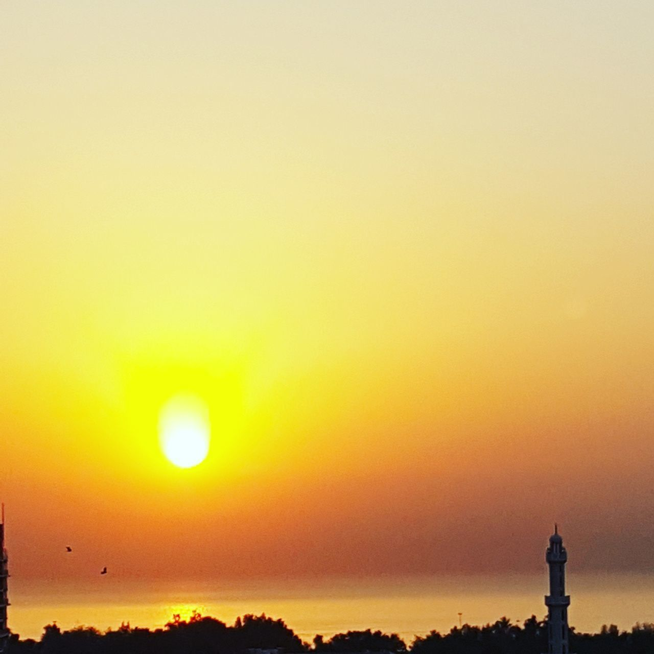 sunset, orange color, silhouette, beauty in nature, nature, scenics, tranquility, copy space, travel destinations, tranquil scene, sun, outdoors, sky, no people, statue, clear sky, day