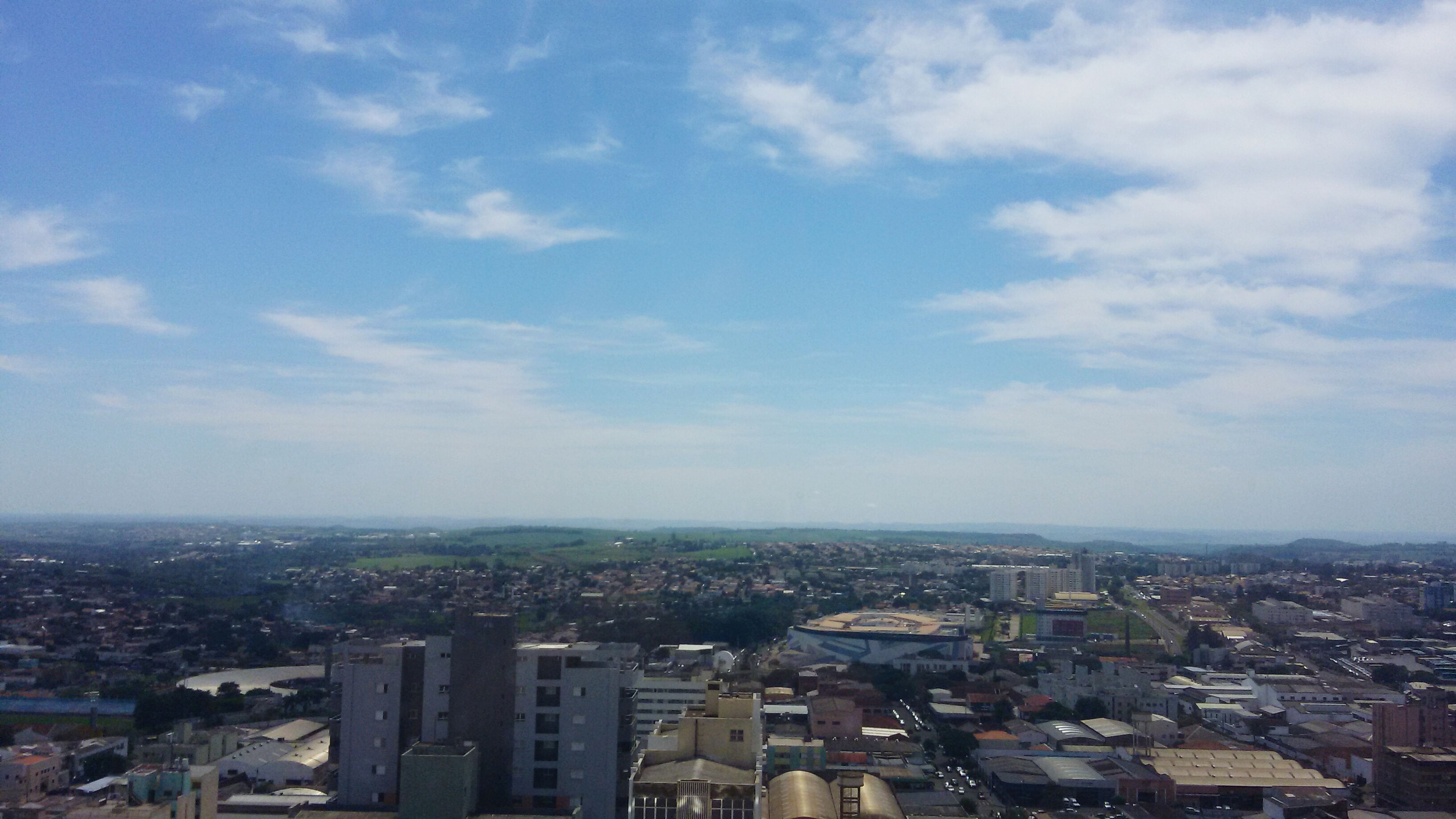 cityscape, building exterior, city, architecture, built structure, crowded, sky, high angle view, residential district, cloud - sky, aerial view, residential building, residential structure, cloud, city life, skyscraper, outdoors, no people, day, cloudy