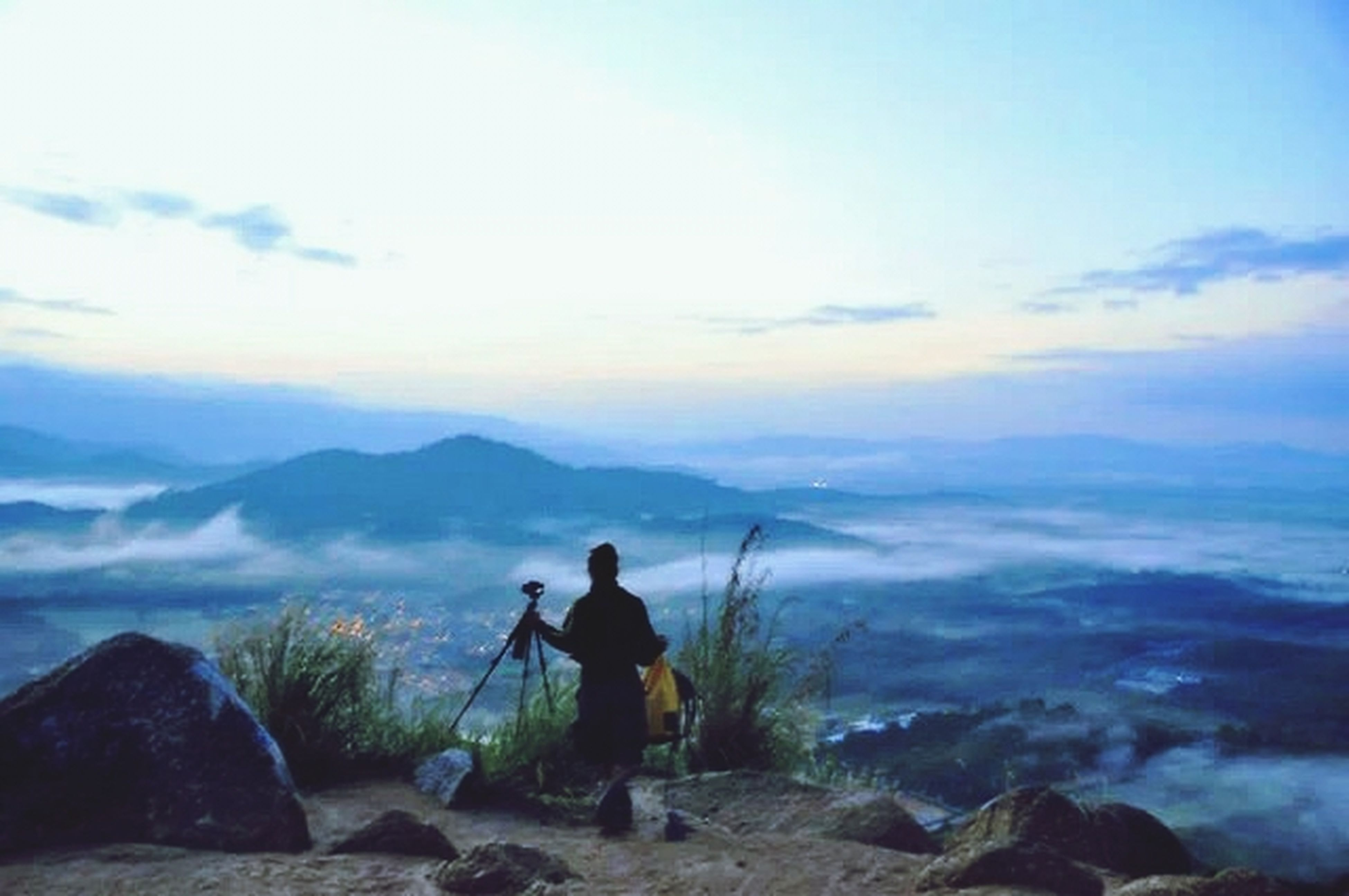 leisure activity, lifestyles, mountain, full length, hiking, men, tranquil scene, rear view, sky, scenics, tranquility, beauty in nature, mountain range, landscape, nature, standing, vacations, backpack