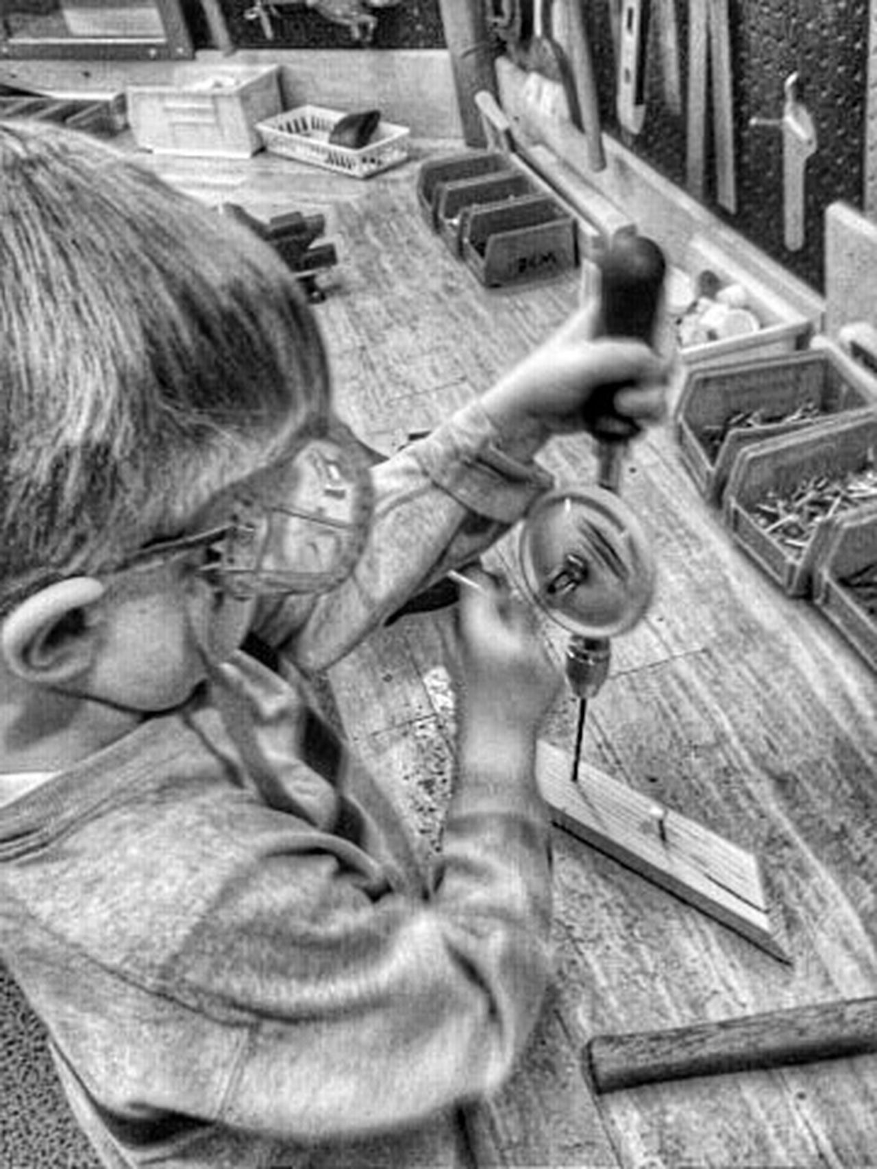 Boy learning wood working EyeEm Best Shots Eye4photography  Carpenter Learn School Wood - Material Wood Having Fun Children Children Photography Children's Portraits Childhood Memories Kids Playing Child Boy Childhood Black And White Black & White Black&white Blackandwhite Shop Class Carpentry Playing