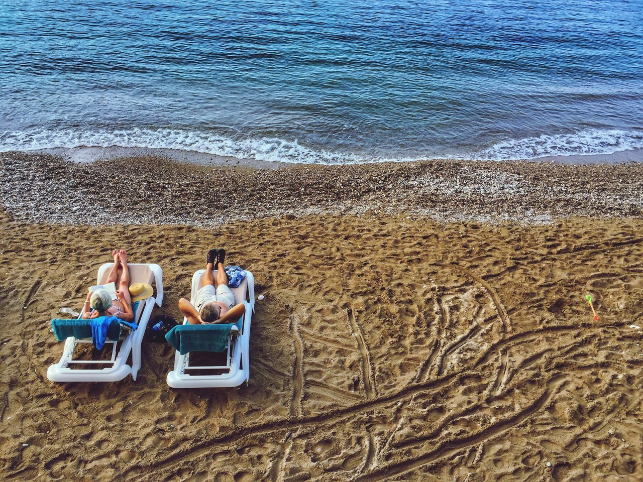 Sunbathing Couple Vacations Beach Sea Water Vacations Real People Togetherness Sand Outdoors Nature Women Beauty In Nature Leisure Activity Day Men Friendship