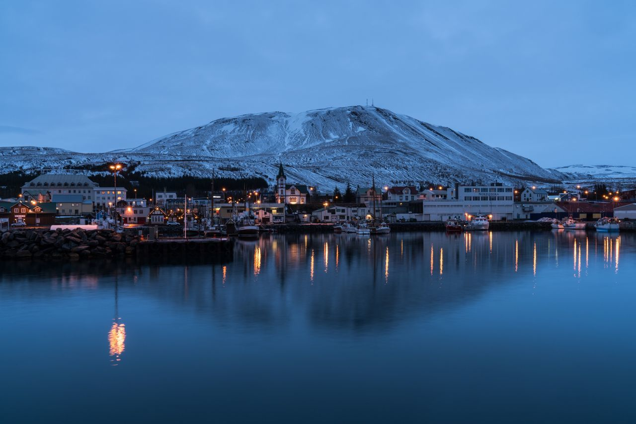 The Bay. Mountain Water Scenics Outdoors Nature Blue Waterfront Beauty In Nature Winter Cold Temperature Iceland Memories Iceland_collection Iceland Iceland Trip Husavik The Bay Reflections In The Water Reflection Reflections Water Reflections Blue Hour Dusk Nightphotography Travel Photography Roadtrip