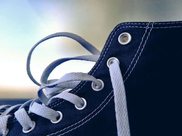 Eyelet Eyelets Fashion Shoe Blue Chuck Chucks Close-up Day Detail Indoors  Lace Metallic No People Seam Shoelace Shoes Silver  Still Life Textile