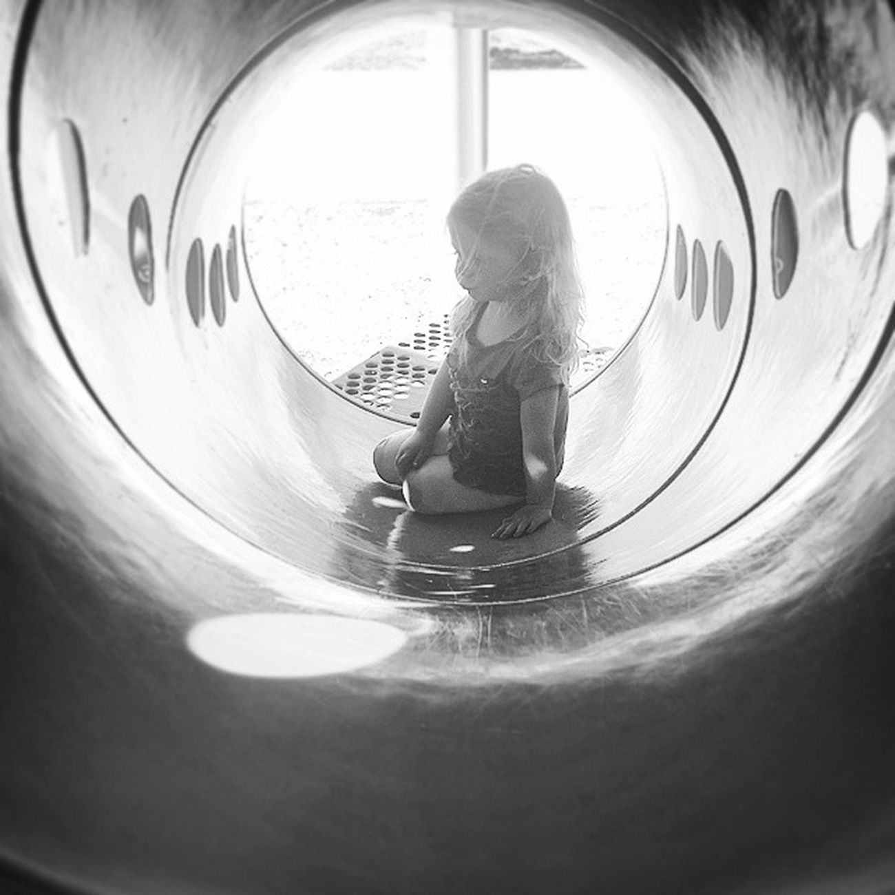 Playground tunnels..one of my favorite playground props and the most ridiculous thing I crawl through for my kids. Justleesha Momswithcameras Cmglimpse Mamalode clickinmoms blackandwhite yourlifeunscripted littleandbrave thebloomforum mobilesnapscollaborative
