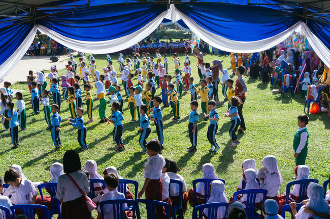 Large Group Of People Person Togetherness Crowd Outdoors Celebration Event Performance Group The Color Of School People And Places Fresh On Eyeem  Streetphotography Streetphoto Street Streetphoto_color People Kids School Kindergarten Sonyphotography Sonyalpha Sonyimages