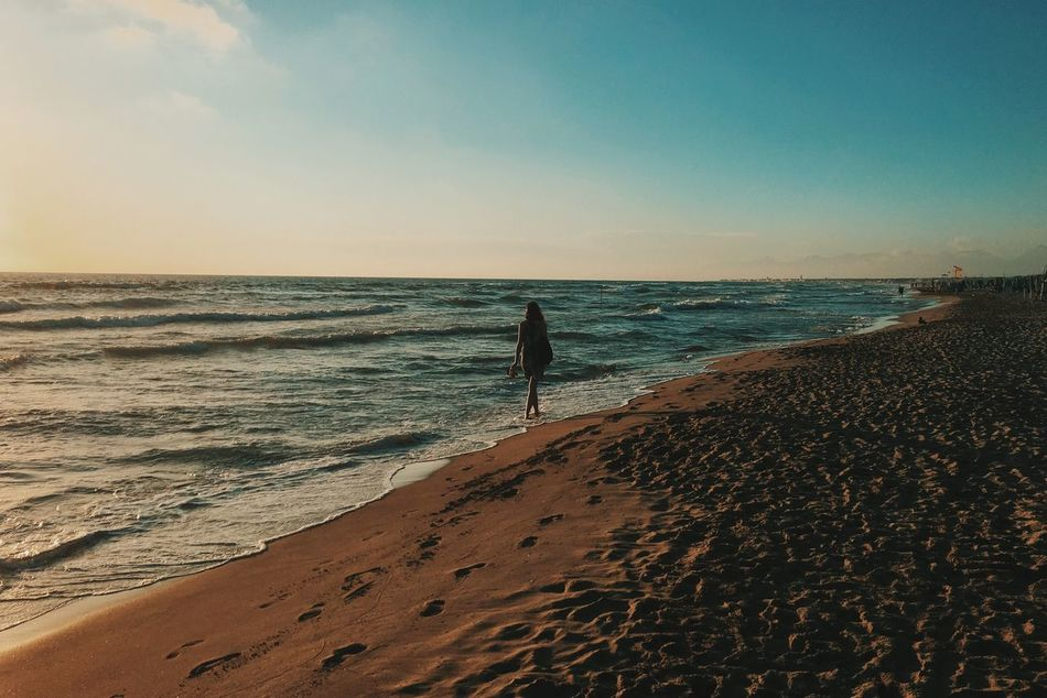 Sea Beach Horizon Over Water Sand One Person Rear View Water Sky Real People Full Length Lifestyles Shore Nature Outdoors Leisure Activity Scenics Beauty In Nature Vacations Wave Day