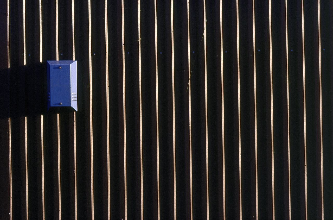 Alarm. Industrial Warehouse, U.K. Alarm Black Blue Building Exterior Day Facade Building Facade Detail Graphic Metal Doors My Perspective My Point Of View No People Outdoors Sheffield Side Lighting Travel Photography Uk Urban Geometry Urbanphotography