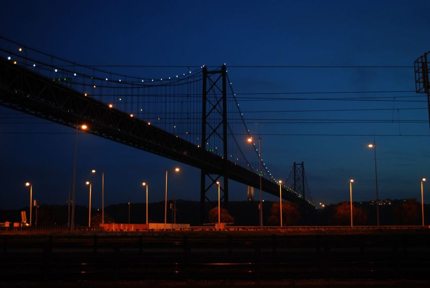 Night Illuminated Connection Transportation Bridge - Man Made Structure Architecture Built Structure Engineering Sky Lighting Equipment No People Outdoors Low Angle View Suspension Bridge Water The City Light Architecture City Lisbon February Art Lisboa Portugal Transportation Portugal Belém