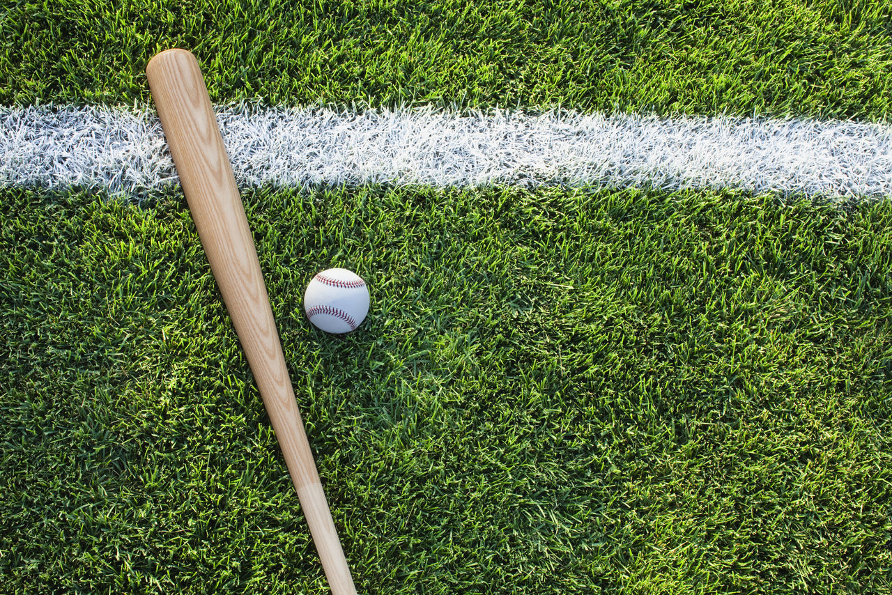 Baseball bat and ball on green grass field with white stripe viewed from above Baseball Baseball Bat Bat Color Image Field Grass Green No People Overhead View Photography Playing Field Stripes Straight Lines Viewed From Above White