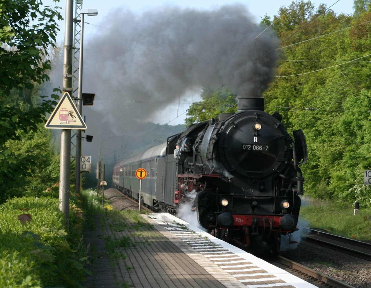 train - vehicle, steam train, transportation, rail transportation, smoke - physical structure, locomotive, railroad track, mode of transport, public transportation, outdoors, day, steam, old-fashioned, no people, tree, sky
