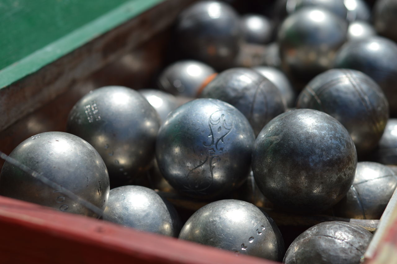 Close-Up Of Shiny Metal Balls In Container