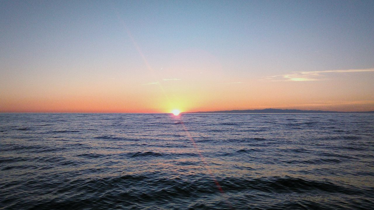 sea, beauty in nature, scenics, water, sunset, horizon over water, nature, sun, tranquility, tranquil scene, sky, idyllic, waterfront, rippled, no people, outdoors, clear sky, wave, day