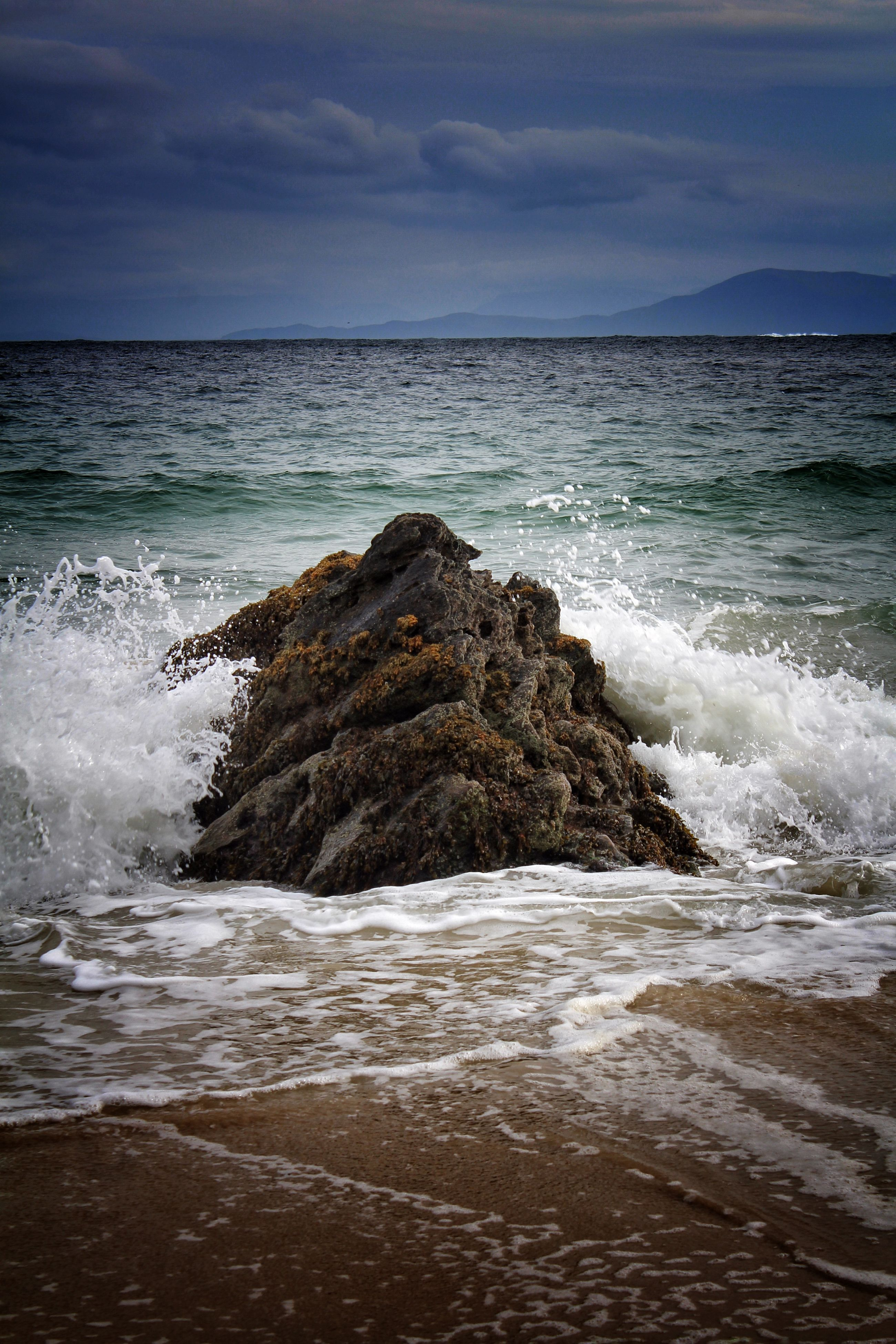 sea, water, horizon over water, wave, beach, scenics, sky, surf, beauty in nature, tranquil scene, shore, tranquility, nature, idyllic, tide, motion, cloud - sky, seascape, rock - object, coastline