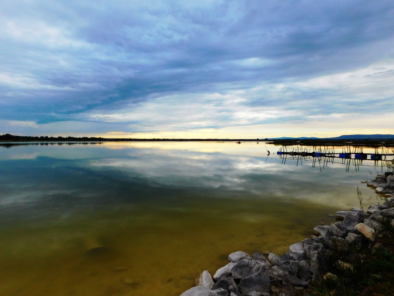 sky, cloud - sky, water, built structure, architecture, tranquil scene, scenics, nature, tranquility, reflection, beauty in nature, sea, outdoors, no people, day