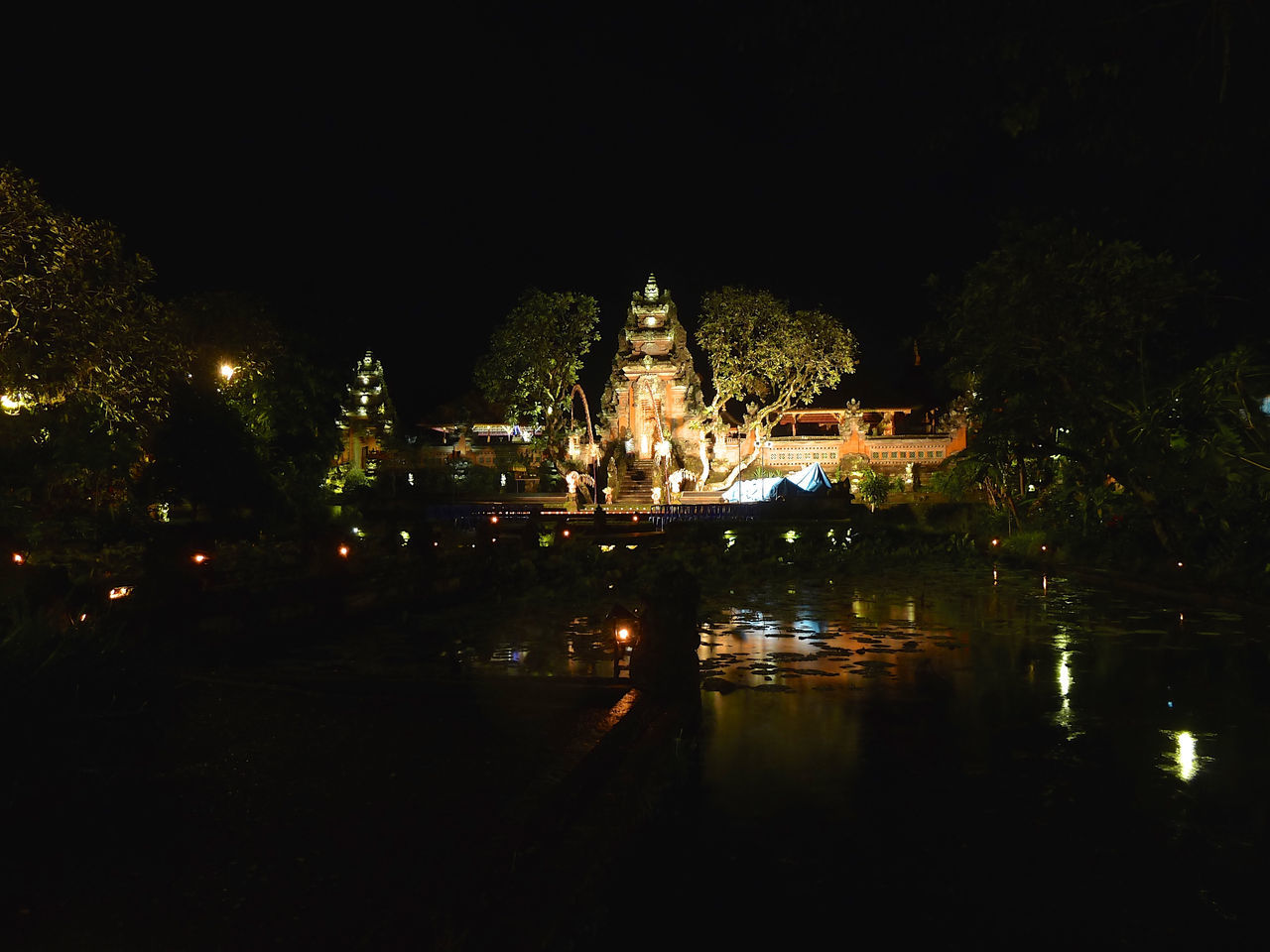 Architecture Building Exterior City Dance Show Hinduism Illuminated Nature Night No People Outdoors Pond Prayer Reflection Religion Sky Temple Travel Destinations Tree Ubud Water