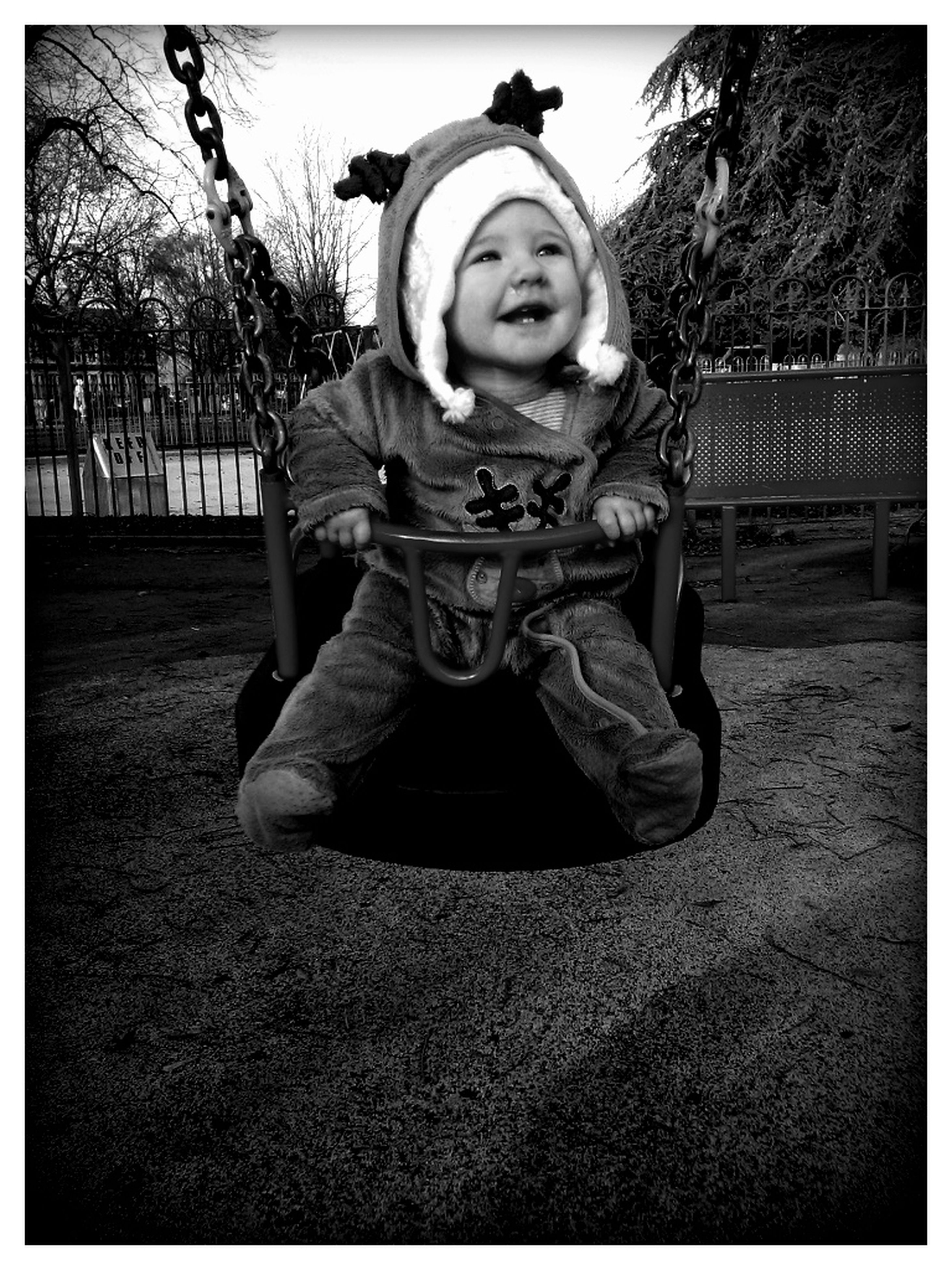 transfer print, auto post production filter, childhood, person, full length, elementary age, casual clothing, park - man made space, portrait, lifestyles, leisure activity, looking at camera, front view, girls, sitting, tree, park, cute