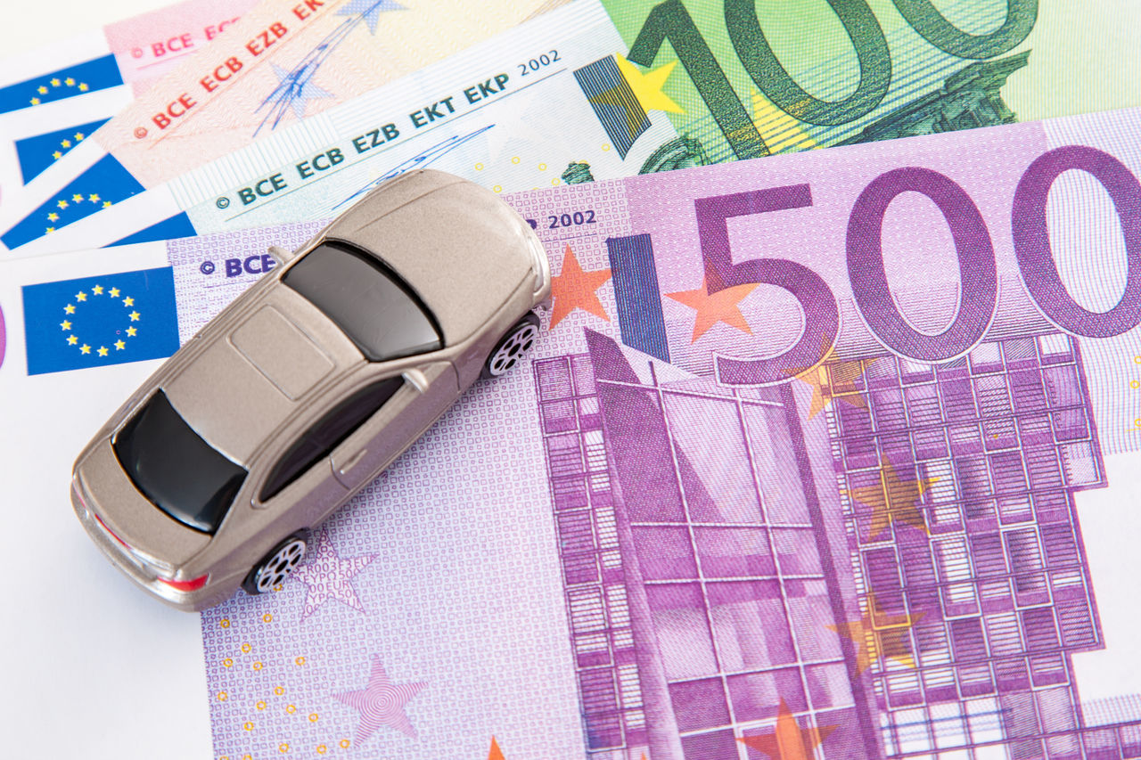 Toy car on euro note Budget Car Insurance Costs Euro Notes Expenses Metaphor Purchase Sale Stock Photo Symbolic